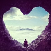 monk in heart cave meditating
